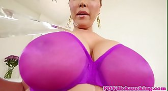 Asian milf sucking cock and gives titjob